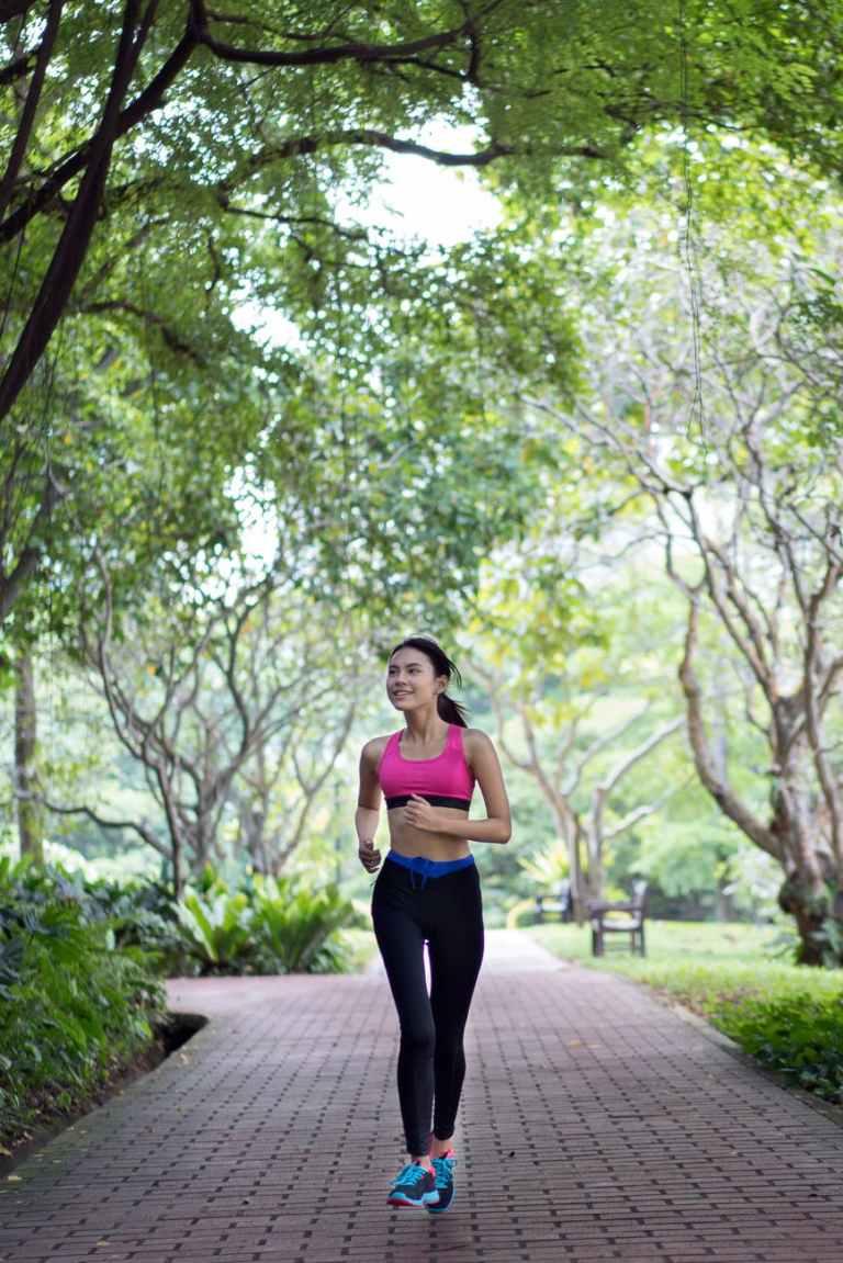 woman running on pathway